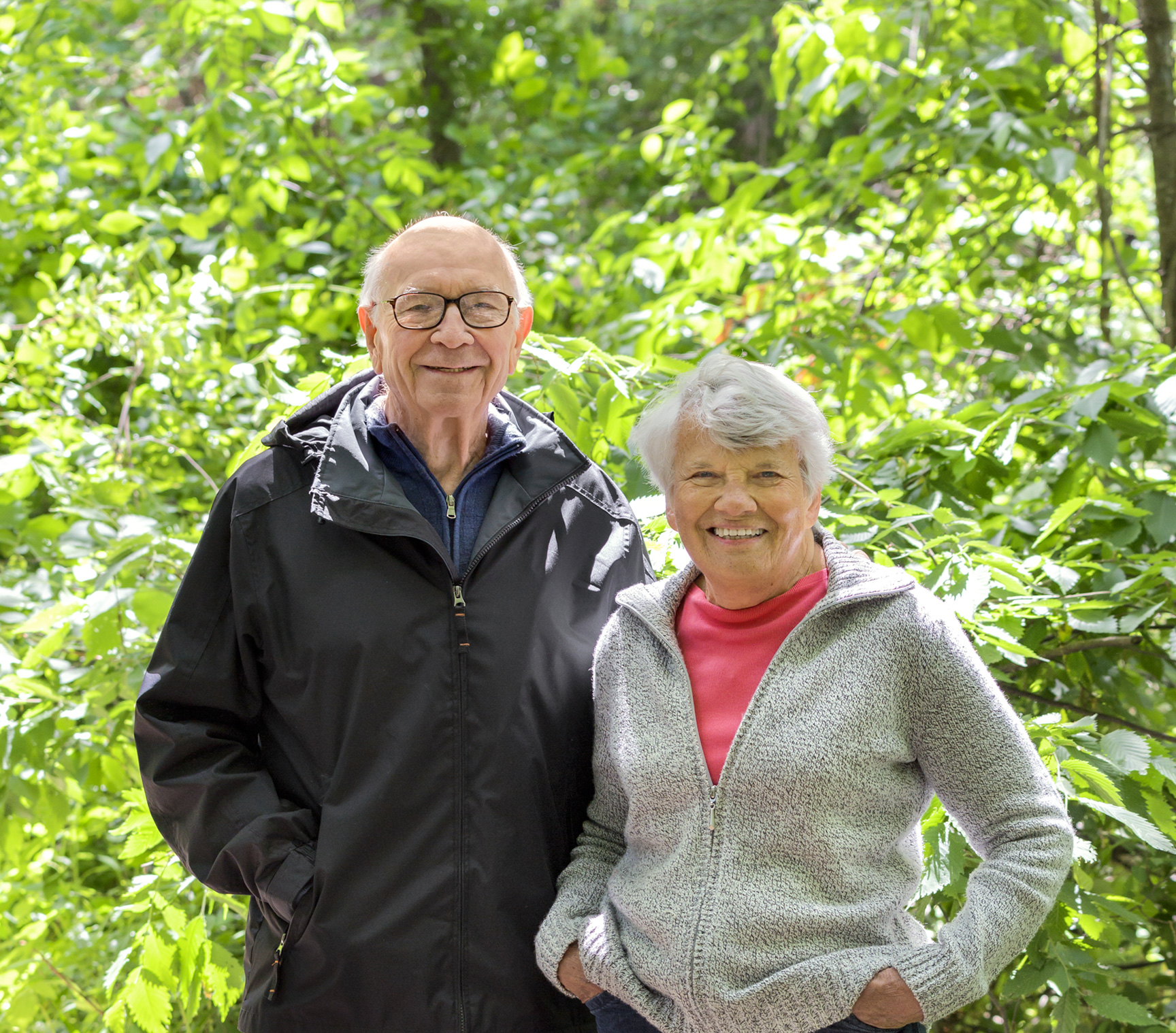 Two Independent Living Residents at RiverWoods Manchester enjoying the walking trails through the woods in Manchester, NH